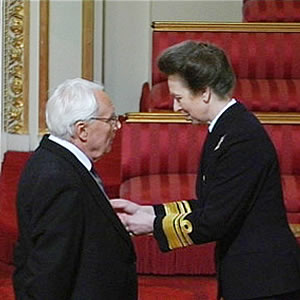 peter collinge obe receiving award